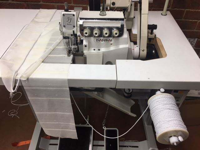 Kansai Special overlock for sewing beaded lead weight to curtains