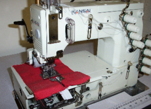 Kansai Special DFB-1404P-Z Continuous Zip Machine